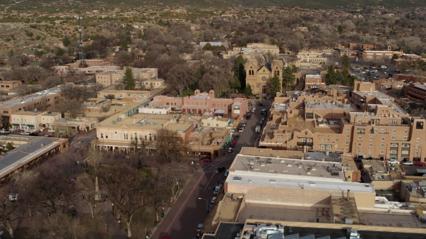 5.7K stock footage aerial video flyby Santa Fe Plaza to approach the cathedral in Santa Fe, New Mexico Aerial Stock Footage | DX0002_131_028