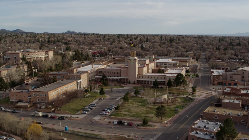 5.7K stock footage aerial video orbit the Bataan Memorial Building before descending, Santa Fe, New Mexico Aerial Stock Footage   DX0002_131_034