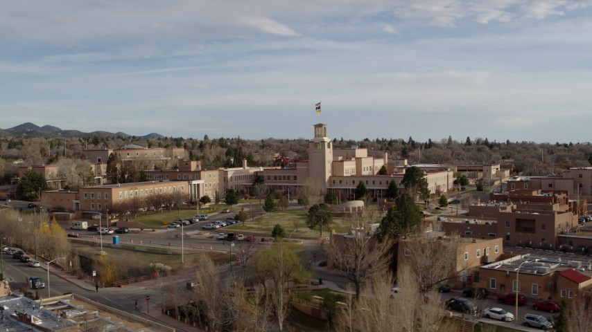 5.7K stock footage aerial video orbit the front of the Bataan Memorial Building before ascending, Santa Fe, New Mexico Aerial Stock Footage | DX0002_131_035