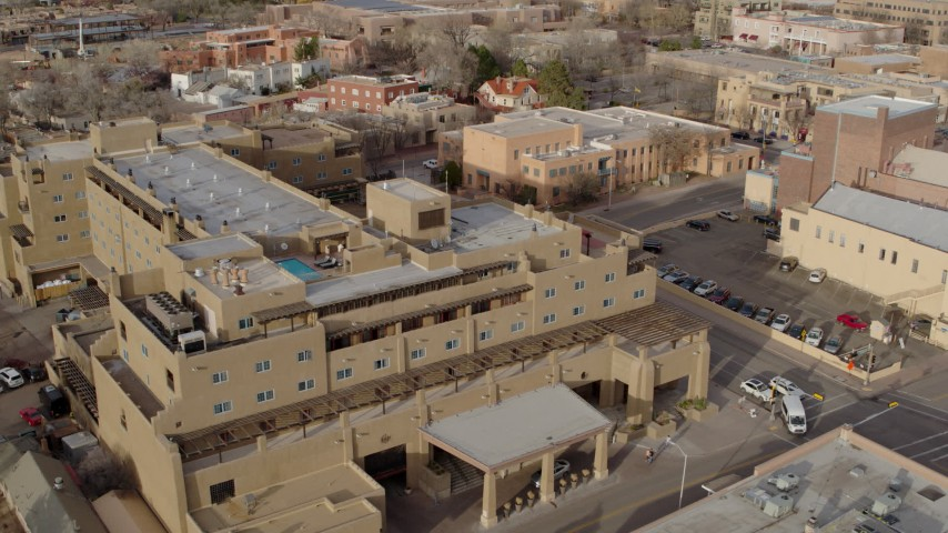 5.7K stock footage aerial video fly away from and orbit the Eldorado Hotel & Spa hotel, Santa Fe, New Mexico Aerial Stock Footage | DX0002_131_038