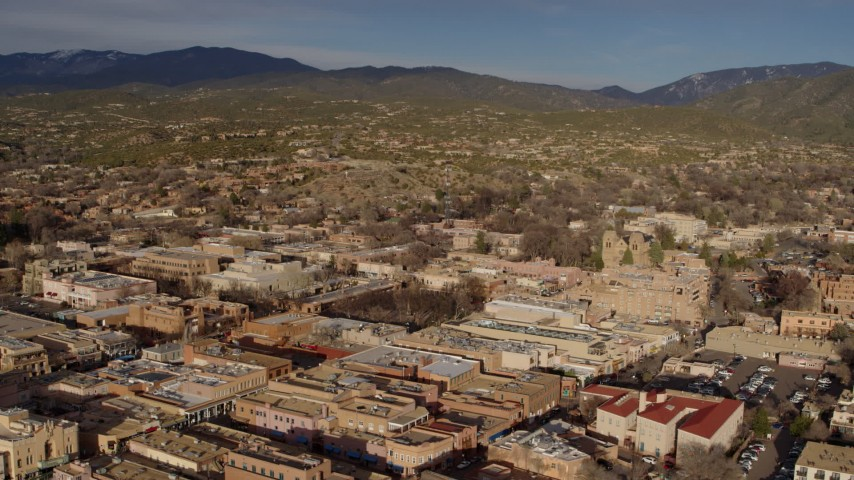 5.7K stock footage aerial video flying past downtown area of Santa Fe, New Mexico Aerial Stock Footage   DX0002_132_005