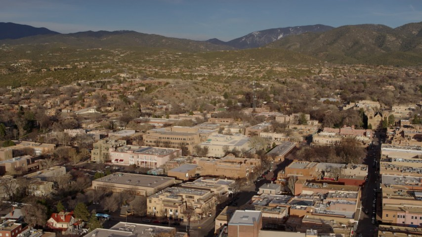 5.7K stock footage aerial video descending past downtown buildings, Santa Fe, New Mexico Aerial Stock Footage | DX0002_132_006