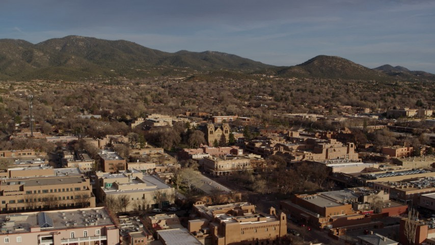 5.7K stock footage aerial video of the cathedral seen while passing Santa Fe Plaza, Santa Fe, New Mexico Aerial Stock Footage   DX0002_132_012