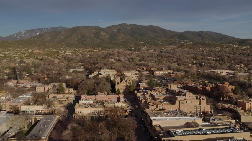 5.7K stock footage aerial video of the cathedral seen while flying by Santa Fe Plaza, Santa Fe, New Mexico Aerial Stock Footage   DX0002_132_013