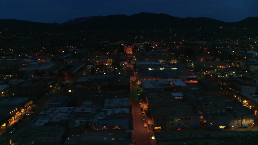 5.7K stock footage aerial video flyby San Francisco Street with view of cathedral at night, Santa Fe, New Mexico Aerial Stock Footage | DX0002_132_016