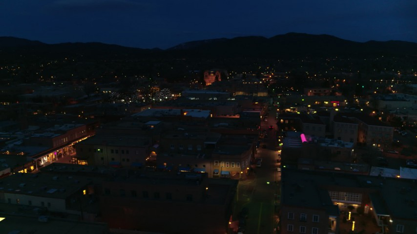5.7K stock footage aerial video flyby downtown, reveal San Francisco Street leading to cathedral at night, Santa Fe, New Mexico Aerial Stock Footage | DX0002_132_017