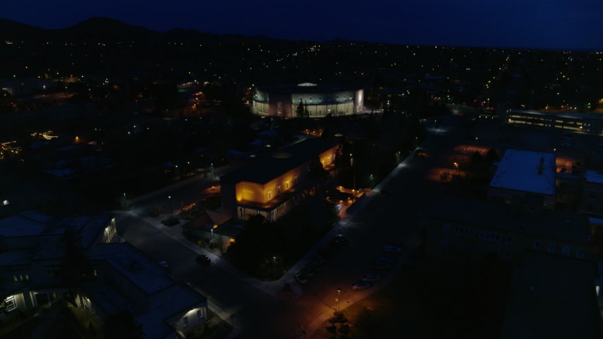 5.7K stock footage aerial video view approach and orbit New Mexico State Capitol at night, Santa Fe, New Mexico Aerial Stock Footage   DX0002_132_021