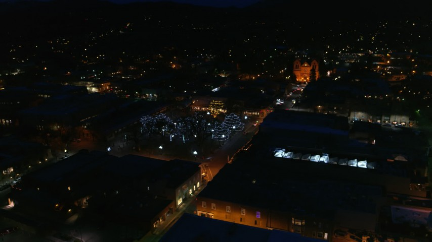 5.7K stock footage aerial video reverse view of Santa Fe Plaza near the cathedral at night, Santa Fe, New Mexico Aerial Stock Footage | DX0002_132_029
