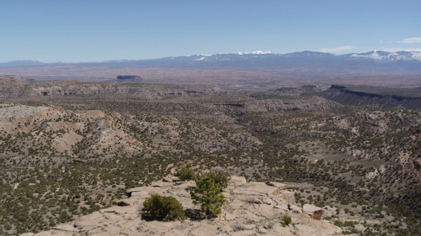 5.7K stock footage aerial video fly over the top of a desert mesa for wide view of mesas and mountains in New Mexico Aerial Stock Footage | DX0002_133_012