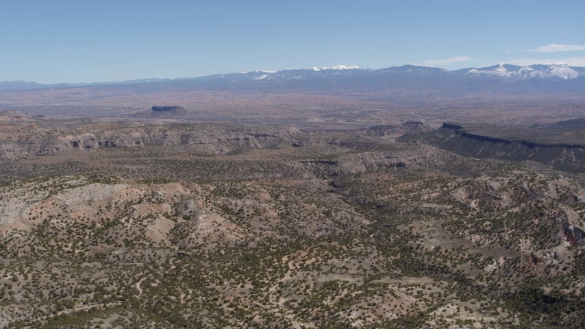 5.7K stock footage aerial video reverse view of desert mesas and distant mountains in New Mexico Aerial Stock Footage | DX0002_133_013
