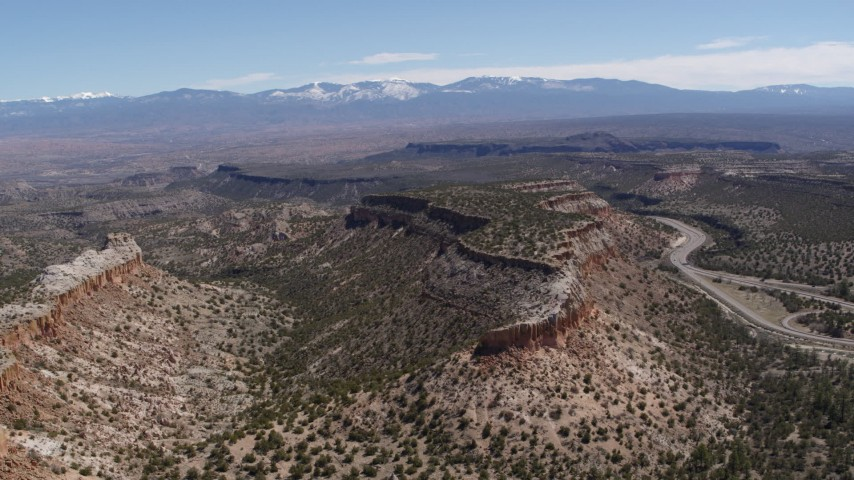 5.7K stock footage aerial video of flying away from flat desert mesas and distant mountains in New Mexico Aerial Stock Footage | DX0002_133_016