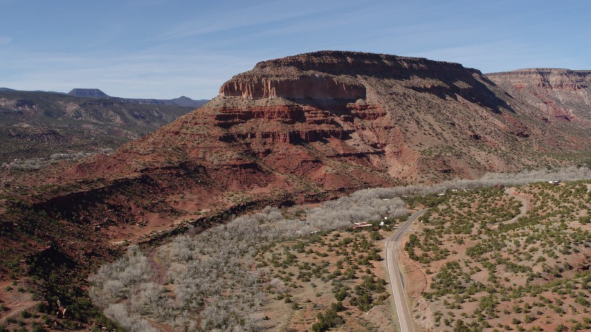 5.7K stock footage aerial video of orbiting a butte beside a road, New Mexico Aerial Stock Footage | DX0002_135_003