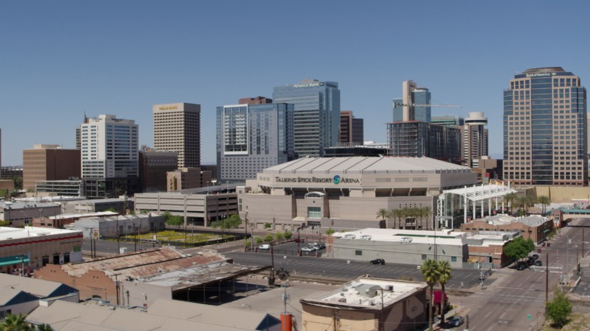 5.7K stock footage aerial video of passing the arena near office buildings in Downtown Phoenix, Arizona Aerial Stock Footage | DX0002_136_001