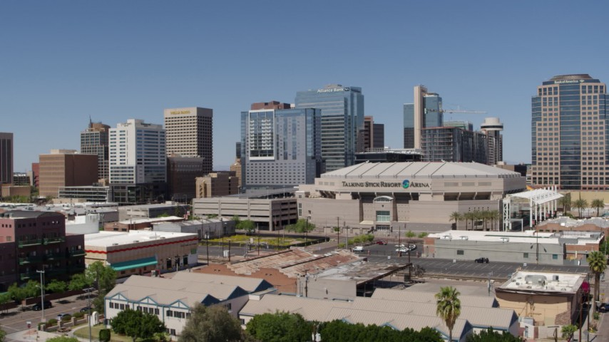 5.7K stock footage aerial video of flying away from the arena and office buildings in Downtown Phoenix, Arizona Aerial Stock Footage | DX0002_136_002