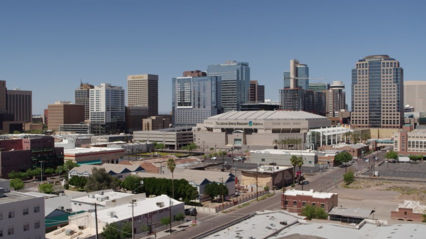 5.7K stock footage aerial video of a view of the arena near office buildings in Downtown Phoenix, Arizona Aerial Stock Footage | DX0002_136_003