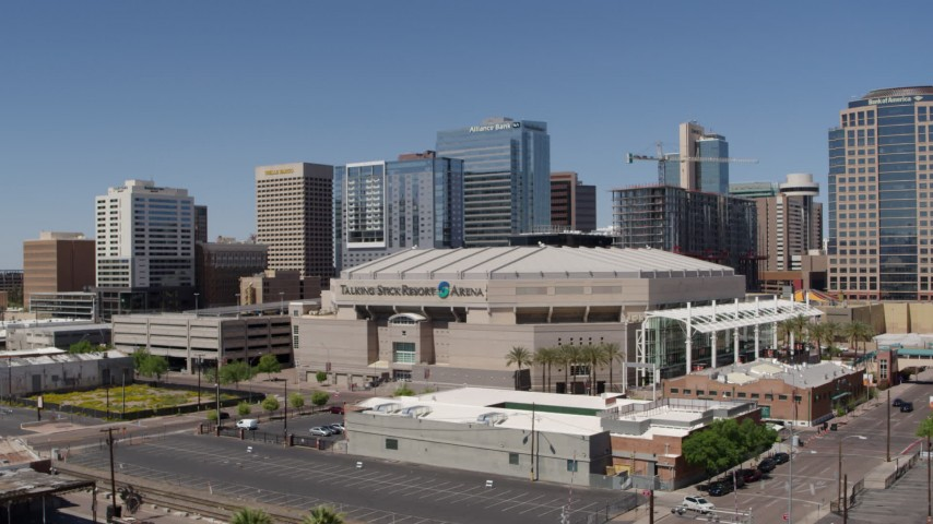 5.7K stock footage aerial video of approaching the arena near office buildings in Downtown Phoenix, Arizona Aerial Stock Footage | DX0002_136_008