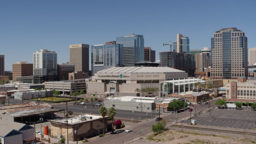 5.7K stock footage aerial video of flying by condo complex to focus on the arena in Downtown Phoenix, Arizona Aerial Stock Footage   DX0002_136_010
