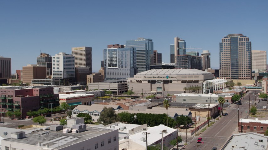 5.7K stock footage aerial video of slowly flying away from the arena and office buildings in Downtown Phoenix, Arizona Aerial Stock Footage | DX0002_136_011