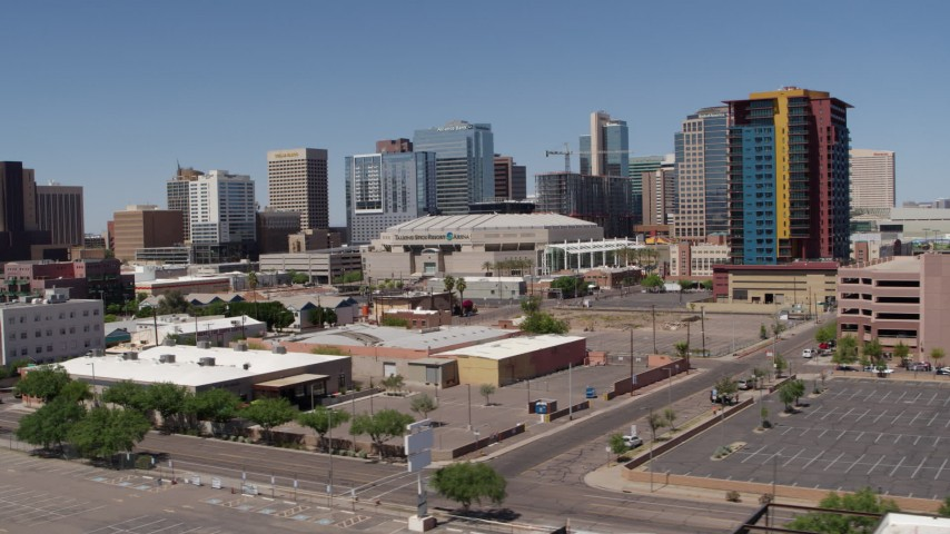 5.7K stock footage aerial video of slowly flying past from the arena and office buildings, reveal condo complex in Downtown Phoenix, Arizona Aerial Stock Footage | DX0002_136_012
