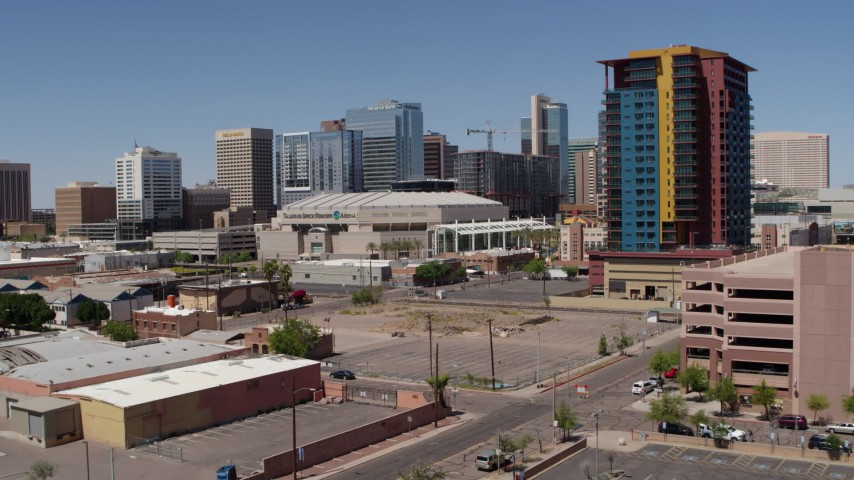 5.7K stock footage aerial video of a slow approach to the arena past the condo complex in Downtown Phoenix, Arizona Aerial Stock Footage | DX0002_136_013