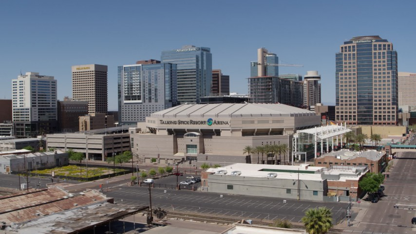 5.7K stock footage aerial video of a slow reverse view from the arena near office buildings in Downtown Phoenix, Arizona Aerial Stock Footage | DX0002_136_014