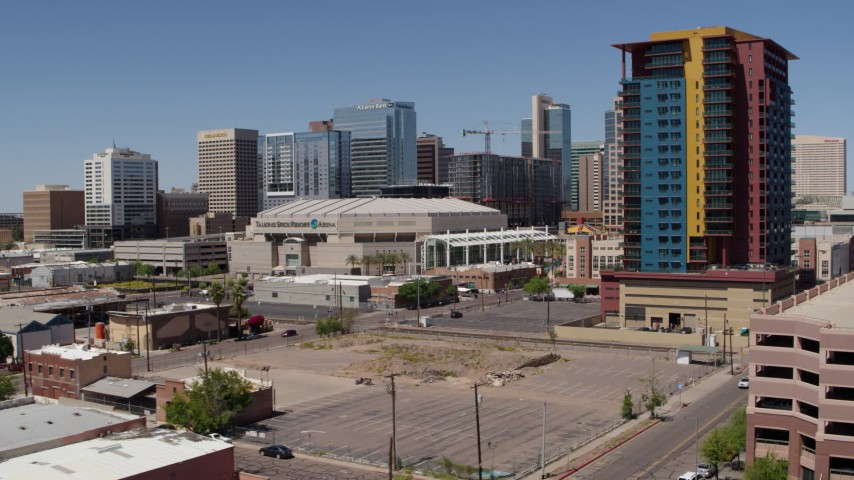 5.7K stock footage aerial video of approaching the arena and condo complex in Downtown Phoenix, Arizona Aerial Stock Footage | DX0002_136_016