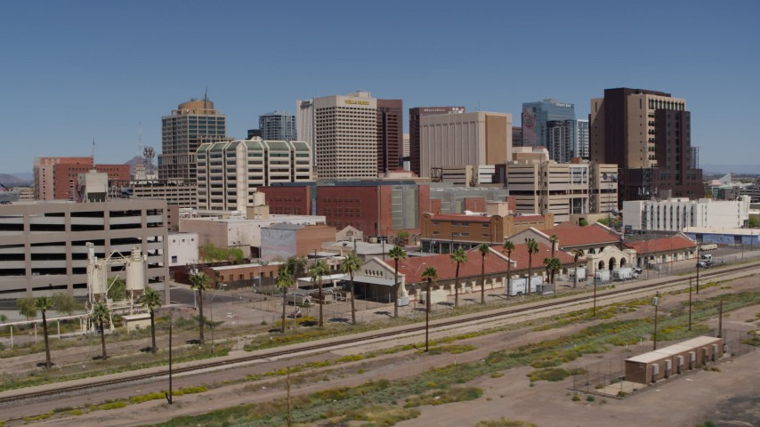 5.7K stock footage aerial video of the city skyline seen from a train station in Downtown Phoenix, Arizona Aerial Stock Footage | DX0002_136_017