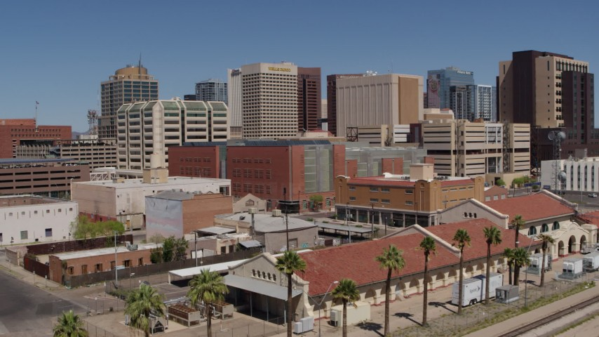 5.7K stock footage aerial video of flying toward a train station and the city skyline of Downtown Phoenix, Arizona Aerial Stock Footage | DX0002_136_022