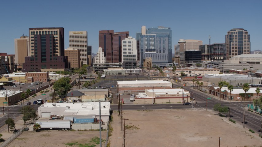 5.7K stock footage aerial video of a reverse view of tall office buildings in Downtown Phoenix, Arizona Aerial Stock Footage | DX0002_136_026