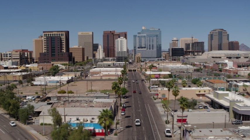 5.7K stock footage aerial video of flying by Central Avenue focused on tall office buildings, Downtown Phoenix, Arizona Aerial Stock Footage | DX0002_136_027