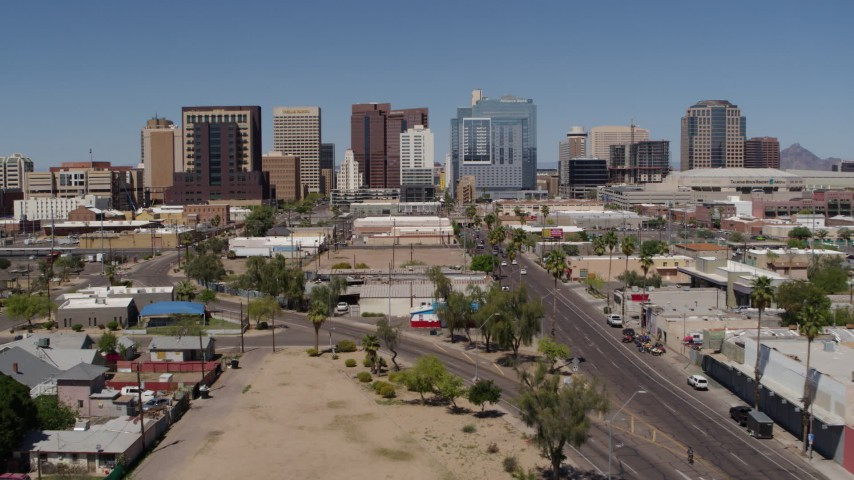 5.7K stock footage aerial video of approaching tall office buildings seen from city streets, Downtown Phoenix, Arizona Aerial Stock Footage | DX0002_136_030