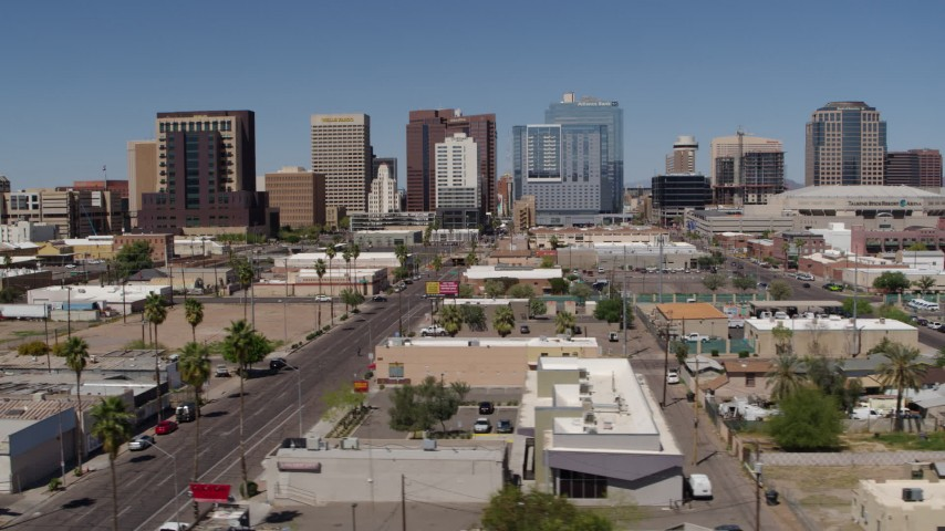 5.7K stock footage aerial video passing Central Avenue with a view of high-rise office buildings, Downtown Phoenix, Arizona Aerial Stock Footage | DX0002_136_032