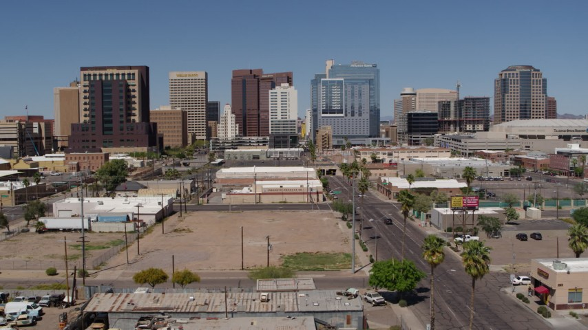 5.7K stock footage aerial video flyby and away from high-rise office buildings, seen from Central Avenue, Downtown Phoenix, Arizona Aerial Stock Footage | DX0002_136_034
