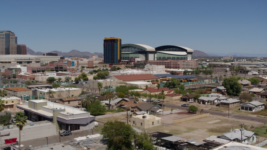 5.7K stock footage aerial video of flying by condominium complex and baseball stadium, Downtown Phoenix, Arizona Aerial Stock Footage | DX0002_136_037