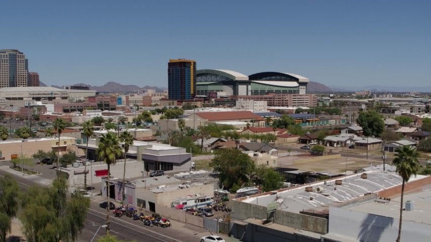 5.7K stock footage aerial video of condominium complex and baseball stadium seen during decent, Downtown Phoenix, Arizona Aerial Stock Footage DX0002_136_039 | Axiom Images