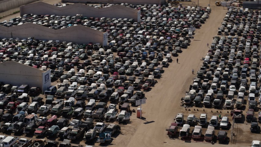 5.7K stock footage aerial video of orbiting cars at an automobile junkyard in Phoenix, Arizona Aerial Stock Footage | DX0002_136_040