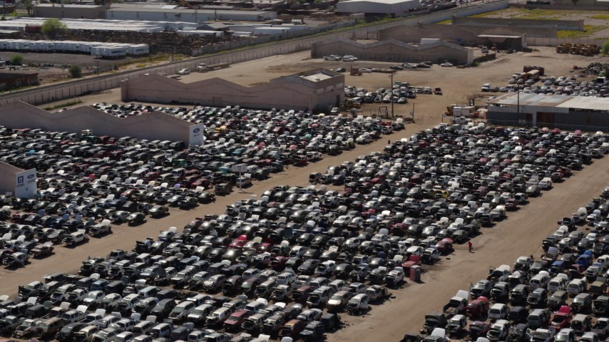 5.7K stock footage aerial video of ascending with a view of cars at an automobile junkyard in Phoenix, Arizona Aerial Stock Footage | DX0002_136_041
