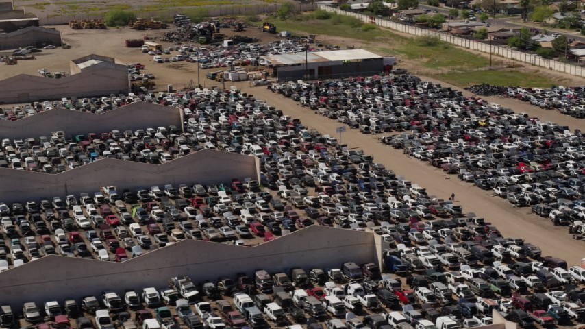 5.7K stock footage aerial video of flying by cars at an automobile junkyard in Phoenix, Arizona Aerial Stock Footage | DX0002_136_042