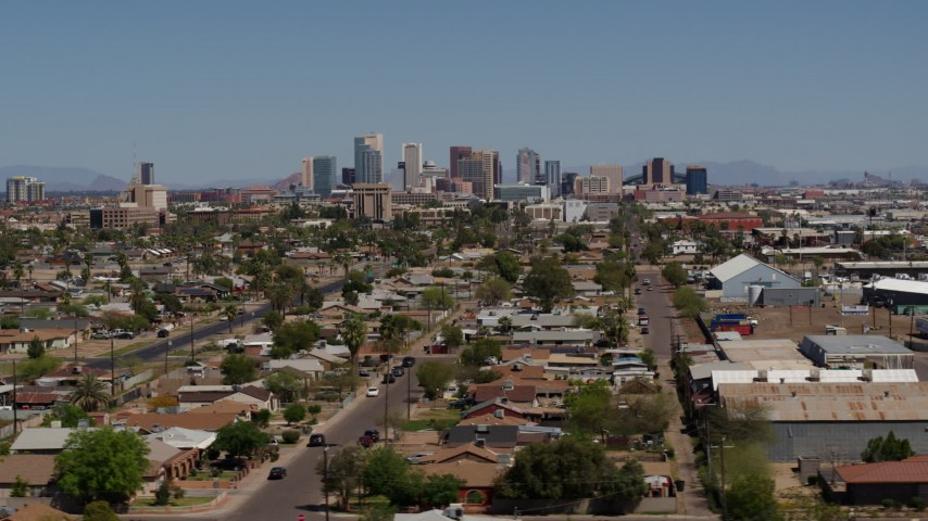 5.7K stock footage aerial video of a view of the city's skyline in the distance, Downtown Phoenix, Arizona Aerial Stock Footage | DX0002_136_050