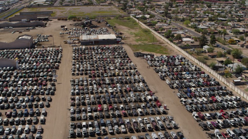 5.7K stock footage aerial video of orbiting rows of cars at an automobile junkyard in Phoenix, Arizona Aerial Stock Footage   DX0002_137_002