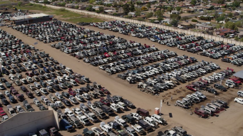 5.7K stock footage aerial video pass and orbit rows of cars at an automobile junkyard in Phoenix, Arizona Aerial Stock Footage | DX0002_137_003