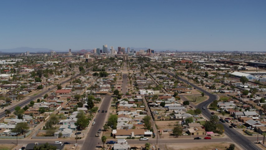5.7K stock footage aerial video of a wide view of urban neighborhoods and the city's skyline in Downtown Phoenix, Arizona Aerial Stock Footage | DX0002_137_005