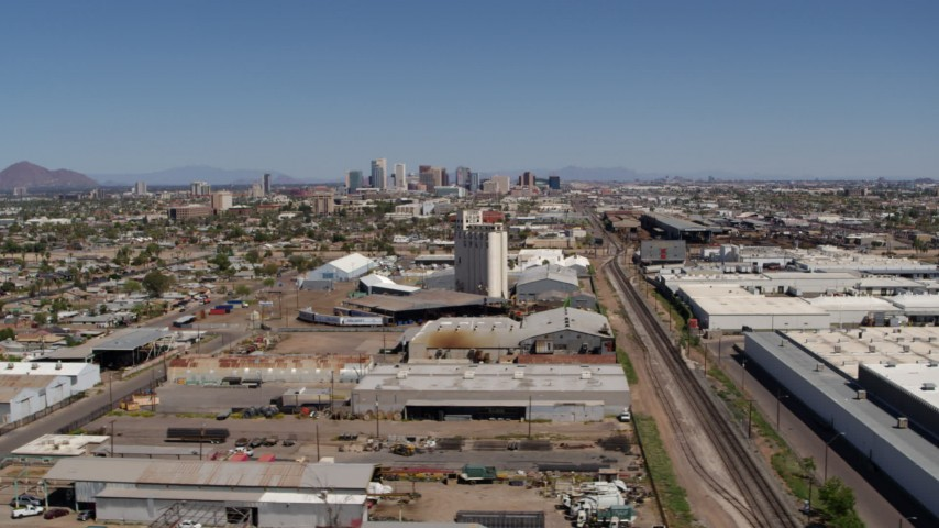 5.7K stock footage aerial video of a wide view of the city's skyline, urban homes, grain elevator and rail in Downtown Phoenix, Arizona Aerial Stock Footage | DX0002_137_006