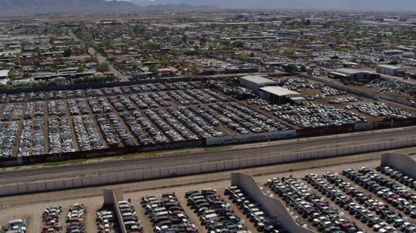 5.7K stock footage aerial video orbit around rows of cars at an automobile junkyard in Phoenix, Arizona Aerial Stock Footage | DX0002_137_010