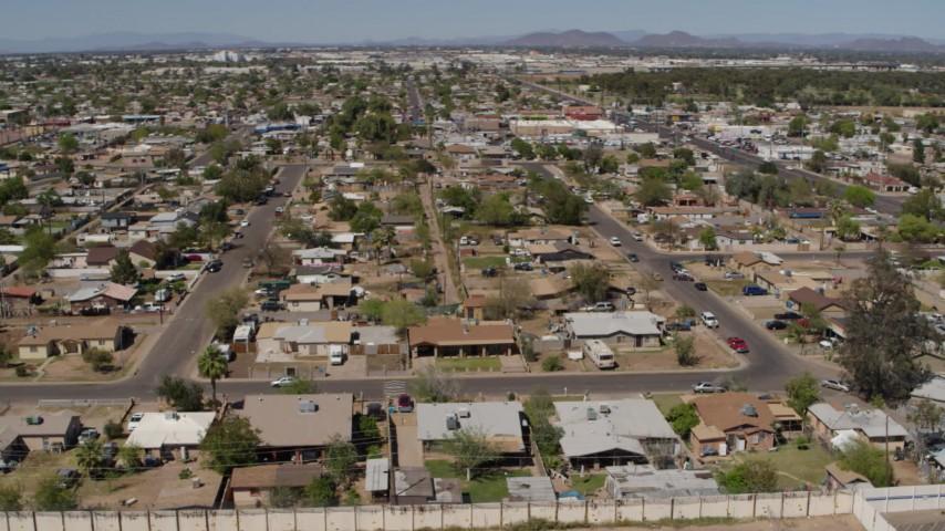 5.7K stock footage aerial video an orbit of urban homes in Phoenix, Arizona Aerial Stock Footage | DX0002_137_013