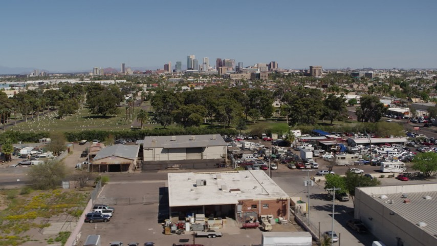 5.7K stock footage aerial video of a wide view of the city's skyline from industrial buildings and cemetery in Downtown Phoenix, Arizona Aerial Stock Footage | DX0002_137_018