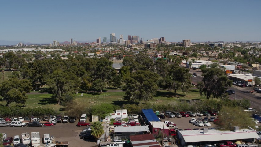 5.7K stock footage aerial video of a wide view of the city's skyline while approaching cemetery in Downtown Phoenix, Arizona Aerial Stock Footage   DX0002_137_019