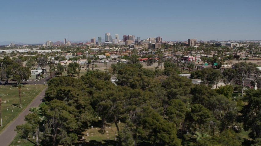 5.7K stock footage aerial video of a wide view of the city's skyline from cemetery in Downtown Phoenix, Arizona Aerial Stock Footage | DX0002_137_020