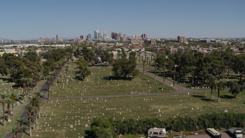 5.7K stock footage aerial video of a reverse view of the city's skyline from cemetery in Downtown Phoenix, Arizona Aerial Stock Footage | DX0002_137_021