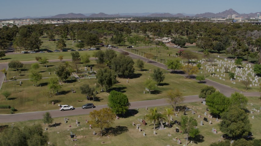5.7K stock footage aerial video orbiting gravestones and green lawn at a cemetery in Phoenix, Arizona Aerial Stock Footage | DX0002_137_025